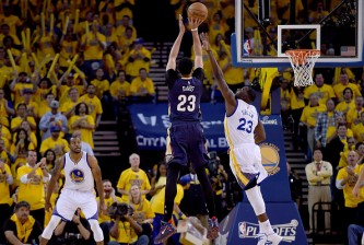 OAKLAND, CA - APRIL 20:  Anthony Davis #23 of the New Orleans Pelicans shoots over Draymond Green #23 of the Golden State Warriors in the first quarter during the first round of the 2015 NBA Playoffs at ORACLE Arena on April 20, 2015 in Oakland, California. NOTE TO USER: User expressly acknowledges and agrees that, by downloading and or using this photograph, User is consenting to the terms and conditions of the Getty Images License Agreement.  (Photo by Thearon W. Henderson/Getty Images)