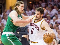 CLEVELAND, OH - APRIL 21: Kevin Love #0 of the Cleveland Cavaliers tries to drive around Kelly Olynyk #41 of the Boston Celtics in the first half during Game Two in the Eastern Conference Quarterfinals of the 2015 NBA Playoffs 2015 at Quicken Loans Arena on April 21, 2015 in Cleveland, Ohio. NOTE TO USER: User expressly acknowledges and agrees that, by downloading and or using this photograph, User is consenting to the terms and conditions of the Getty Images License Agreement. (Photo by Jason Miller/Getty Images)  *** Local Caption *** Kevin Love, Kelly Olynyk