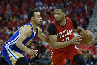 NEW ORLEANS, LA - APRIL 23:  Eric Gordon #10 of the New Orleans Pelicans drives around Stephen Curry #30 of the Golden State Warriors during the first half of Game Three in the first round of the 2015 NBA Playoffs at the Smoothie King Center on April 23, 2015 in New Orleans, Louisiana. NOTE TO USER: User expressly acknowledges and agrees that, by downloading and or using this photograph, User is consenting to the terms and conditions of the Getty Images License Agreement.  (Photo by Stacy Revere/Getty Images)