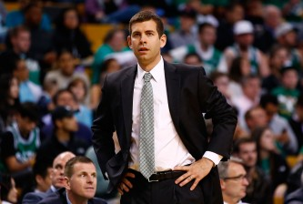 BOSTON, MA - APRIL 16: Head coach Brad Stevens of the Boston Celtics looks on against the Washington Wizards during the game at TD Garden on April 16, 2014 in Boston, Massachusetts. NOTE TO USER: User expressly acknowledges and agrees that, by downloading and or using this photograph, User is consenting to the terms and conditions of the Getty Images License Agreement.  (Photo by Jared Wickerham/Getty Images)