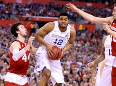 INDIANAPOLIS, IN - APRIL 04: Karl-Anthony Towns #12 of the Kentucky Wildcats handles the ball against Frank Kaminsky #44 of the Wisconsin Badgers in the second half during the NCAA Men's Final Four Semifinal at Lucas Oil Stadium on April 4, 2015 in Indianapolis, Indiana.  (Photo by Andy Lyons/Getty Images)