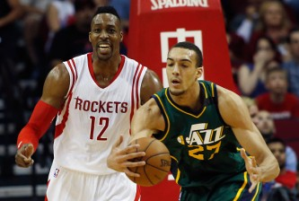 HOUSTON, TX - APRIL 15:   James Harden #13 of the Houston Rockets battles for a rebound with Rodney Hood #5 of the Utah Jazz during their game at the Toyota Center on April 15, 2015 in Houston, Texas. NOTE TO USER: User expressly acknowledges and agrees that, by downloading and/or using this photograph, user is consenting to the terms and conditions of the Getty Images License Agreement. (Photo by Scott Halleran/Getty Images) *** Local Caption *** James Harden; Rodney Hood