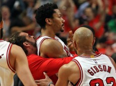 CHICAGO, IL - MAY 08:  (L-R) Joakim Noah #13, Derrick Rose #1 and Taj Gibson #22 of the Chicago Bulls celebrate Rose's game-wiinning shot against the Cleveland Cavaliers in Game Three of the Eastern Conference Semifinals of the 2015 NBA Playoffs at the United Center on May 8, 2015 in Chicago, Illinois. The Bulls defeated the Cavaliers 99-96. NOTE TO USER: User expressly acknowledges and agress that, by downloading and or using the photograph, User is consenting to the terms and conditions of the Getty Images License Agreement.  (Photo by Jonathan Daniel/Getty Images)