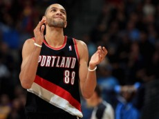 DENVER, CO - NOVEMBER 01:  Nicolas Batum #88 of the Portland Trail Blazers reacts to a play against the Denver Nuggets at Pepsi Center on November 1, 2013 in Denver, Colorado. The Trail Blazers defeated the Nuggets 113-98. NOTE TO USER: User expressly acknowledges and agrees that, by downloading and or using this photograph, User is consenting to the terms and conditions of the Getty Images License Agreement.  (Photo by Doug Pensinger/Getty Images)