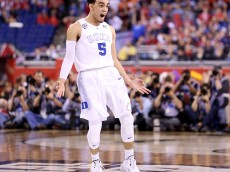 INDIANAPOLIS, IN - APRIL 06:  Tyus Jones #5 of the Duke Blue Devils reacts after a three point basket late in the second half against the Wisconsin Badgers during the NCAA Men's Final Four National Championship at Lucas Oil Stadium on April 6, 2015 in Indianapolis, Indiana.  (Photo by Andy Lyons/Getty Images)