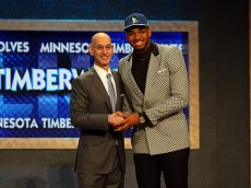 NEW YORK, NY - JUNE 25: Karl-Anthony Towns poses with Commissioner Adam Silver after being drafted first overall by the Minnesota Timberwolves in the First Round of the 2015 NBA Draft at the Barclays Center on June 25, 2015 in the Brooklyn borough of  New York City. NOTE TO USER: User expressly acknowledges and agrees that, by downloading and or using this photograph, User is consenting to the terms and conditions of the Getty Images License Agreement.  (Photo by Elsa/Getty Images)