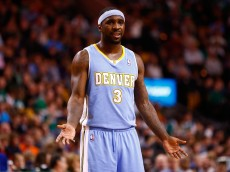 BOSTON, MA - DECEMBER 06: Ty Lawson #3 of the Denver Nuggets reacts following a foul call in the second quarter against the Boston Celtics during the game at TD Garden on December 6, 2013 in Boston, Massachusetts. NOTE TO USER: User expressly acknowledges and agrees that, by downloading and or using this photograph, User is consenting to the terms and conditions of the Getty Images License Agreement.  (Photo by Jared Wickerham/Getty Images)