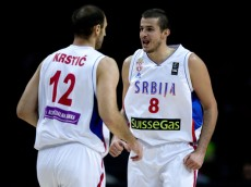 MADRID, SPAIN - SEPTEMBER 10: Nemanja Bjelica (R) of Serbia celebrates with his teammate Nenad Krstic (L) during the 2014 FIBA World Basketball Championship quarter final match between Serbia and Brazil at Palacio de los Deportes on September 10, 2014 in Madrid, Spain.  (Photo by Gonzalo Arroyo Moreno/Getty Images)