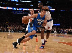 NEW YORK, NY - NOVEMBER 12:  Aaron Gordon #00 of the Orlando Magic dribbles against Amar'e Stoudemire #1 of the New York Knicks during their game at Madison Square Garden on November 12, 2014 in New York City.  (Photo by Al Bello/Getty Images)