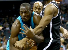 during their game at Time Warner Cable Arena on December 13, 2014 in Charlotte, North Carolina. NOTE TO USER: User expressly acknowledges and agrees that, by downloading and or using this photograph, User is consenting to the terms and conditions of the Getty Images License Agreement.