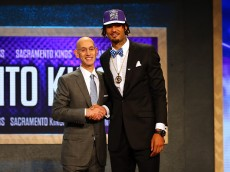 NEW YORK, NY - JUNE 25:  Willie Cauley-Stein poses with Commissioner Adam Silver after being selected sixth overall by the Sacramento Kings in the First Round of the 2015 NBA Draft at the Barclays Center on June 25, 2015 in the Brooklyn borough of  New York City. NOTE TO USER: User expressly acknowledges and agrees that, by downloading and or using this photograph, User is consenting to the terms and conditions of the Getty Images License Agreement.  (Photo by Elsa/Getty Images)