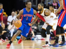 CLEVELAND, OH -  APRIL 13: Reggie Jackson #1 of the Detroit Pistons drives around Kyrie Irving #2 of the Cleveland Cavaliers during the first half at Quicken Loans Arena on April 13, 2014 in Cleveland, Ohio. NOTE TO USER: User expressly acknowledges and agrees that, by downloading and or using this photograph, User is consenting to the terms and conditions of the Getty Images License Agreement. (Photo by Jason Miller/Getty Images)