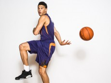 TARRYTOWN, NY - AUGUST 08:  Devin Booker #1 of the Phoenix Suns poses for a portrait during the 2015 NBA rookie photo shoot on August 8, 2015 at the Madison Square Garden Training Facility in Tarrytown, New York. NOTE TO USER: User expressly acknowledges and agrees that, by downloading and or using this photograph, User is consenting to the terms and conditions of the Getty Images License Agreement. (Photo by Nick Laham/Getty Images)