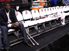 PORTLAND, OR - OCTOBER 10:  Greg Oden #52 of the Portland Trail Blazers, who is out for the season after under going micro fracture surgery in his knee, sits on the bench to watch a pre-season game against the Los Angeles Clippers at the Rose Garden on October 10, 2007 in Portland, Oregon.  NOTE TO USER: User expressly acknowledges and agrees that, by downloading and or using this Photograph, user is consenting to the terms and conditions of the Getty Images License Agreement.  (Photo by Jonathan Ferrey/Getty Images)
