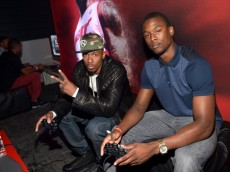 WEST HOLLYWOOD, CA - SEPTEMBER 24:  TV personality Nick Cannon (L) and professional basketball player Harrison Barnes attend the NBA 2K14 premiere party at Greystone Manor on September 24, 2013 in West Hollywood, California.  (Photo by Charley Gallay/Getty Images for 2K)