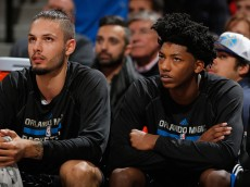DENVER, CO - JANUARY 07:  (L-R) Evan Fournier #10 and Elfrid Payton #4 of the Orlando Magic look on from the bench against the Denver Nuggets at Pepsi Center on January 7, 2015 in Denver, Colorado. The Nuggets defeated the Magic 93-90. NOTE TO USER: User expressly acknowledges and agrees that, by downloading and or using this photograph, User is consenting to the terms and conditions of the Getty Images License Agreement.  (Photo by Doug Pensinger/Getty Images)