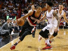 MIAMI, FL - DECEMBER 20:  C.J. McCollum #3 of the Portland Trail Blazers drives on Gerald Green #14 of the Miami Heat during a game  at American Airlines Arena on December 20, 2015 in Miami, Florida. NOTE TO USER: User expressly acknowledges and agrees that, by downloading and/or using this photograph, user is consenting to the terms and conditions of the Getty Images License Agreement. Mandatory copyright notice:  (Photo by Mike Ehrmann/Getty Images)