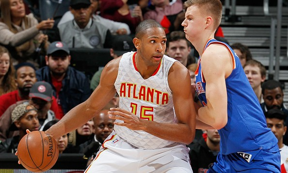 ATLANTA, GA - JANUARY 05:  Kristaps Porzingis #6 of the New York Knicks defends against Al Horford #15 of the Atlanta Hawks at Philips Arena on January 5, 2016 in Atlanta, Georgia.  NOTE TO USER User expressly acknowledges and agrees that, by downloading and or using this photograph, user is consenting to the terms and conditions of the Getty Images License Agreement.  (Photo by Kevin C. Cox/Getty Images)