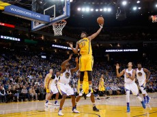 OAKLAND, CA - JANUARY 22:  Myles Turner #33 of the Indiana Pacers makes a rebound against the Golden State Warriors at ORACLE Arena on January 22, 2016 in Oakland, California. NOTE TO USER: User expressly acknowledges and agrees that, by downloading and or using this photograph, User is consenting to the terms and conditions of the Getty Images License Agreement.  (Photo by Ezra Shaw/Getty Images)