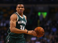 BOSTON, MA - FEBRUARY 25:  Giannis Antetokounmpo #34 of the Milwaukee Bucks carries the ball against the Boston Celtics during the first quarter at TD Garden on February 25, 2016 in Boston, Massachusetts.  (Photo by Maddie Meyer/Getty Images)