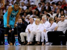 MIAMI, FL - APRIL 20:  Kemba Walker #15 of the Charlotte Hornets looks on during game two of the Eastern Conference Quarterfinals of the 2016 NBA Playoffs against the Miami Heat at American Airlines Arena on April 20, 2016 in Miami, Florida. NOTE TO USER: User expressly acknowledges and agrees that, by downloading and or using this photograph, User is consenting to the terms and conditions of the Getty Images License Agreement.  (Photo by Mike Ehrmann/Getty Images)