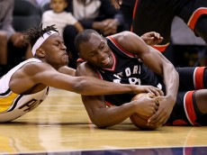 INDIANAPOLIS, IN - APRIL 23:  Myles Turner #33 of the Indiana Pacers and Bismack Biyombo #8 of the Toronto Raptors battle for a loose ball during game four of the 2016 NBA Eastern Conference Quarterfinal Playoffs at Bankers Life Fieldhouse on April 23, 2016 in Indianapolis, Indiana.   NOTE TO USER: User expressly acknowledges and agrees that, by downloading and or using this photograph, User is consenting to the terms and conditions of the Getty Images License Agreement.  (Photo by Andy Lyons/Getty Images)