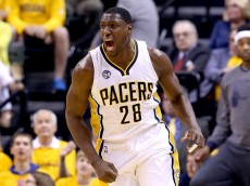 INDIANAPOLIS, IN - APRIL 29:  Ian Mahinmi #28 of the Indiana Pacers celebrates against the Toronto Raptors in game six of the 2016 NBA Playoffs Eastern Conference Quarterfinals on April 29, 2016 in Indianapolis, Indiana.  NOTE TO USER: User expressly acknowledges and agrees that, by downloading and or using this photograph, User is consenting to the terms and conditions of the Getty Images License Agreement.  (Photo by Andy Lyons/Getty Images)