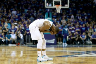 CHARLOTTE, NC - APRIL 29:  Kemba Walker #15 of the Charlotte Hornets reacts after a call against the Miami Heat during game six of the Eastern Conference Quarterfinals of the 2016 NBA Playoffs at Time Warner Cable Arena on April 29, 2016 in Charlotte, North Carolina.  NOTE TO USER: User expressly acknowledges and agrees that, by downloading and or using this photograph, User is consenting to the terms and conditions of the Getty Images License Agreement.  (Photo by Streeter Lecka/Getty Images)
