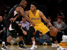LOS ANGELES, CA - APRIL 06:  D'Angelo Russell #1 of the Los Angeles Lakers handles the ball against Chris Paul #3 of the Los Angeles Clippers during the first half of an NBA game between the Los Angeles Clippers and Los Angeles Lakers on April 6, 2016 at Staples Center in Los Angeles, California. NOTE TO USER: User expressly acknowledges and agrees that, by downloading and or using this photograph, User is consenting to the terms and conditions of the Getty Images License Agreement. (Photo by Sean M. Haffey/Getty Images)> at Staples Center on April 6, 2016 in Los Angeles, California.  (Photo by Sean M. Haffey/Getty Images)