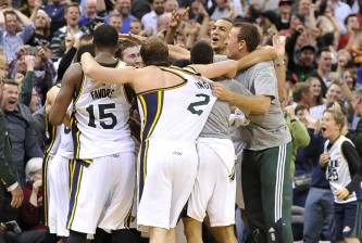 SALT LAKE CITY, UT - NOVEMBER 5: Utah Jazz players mob teammate Gordon Hayward #20 after his buzzer shot beat the Cleveland Cavaliers at EnergySolutions Arena on November 5, 2014 in Salt Lake City, Utah. The Utah Jazz won 102-100. NOTE TO USER: User expressly acknowledges and agrees that, by downloading and using this photograph, User is consenting to the terms and conditions of the Getty Images License Agreement. (Photo by Gene Sweeney Jr/Getty Images)