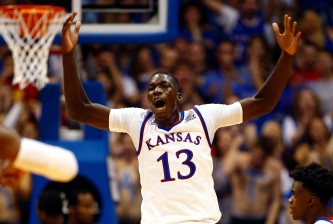 LAWRENCE, KS - DECEMBER 01:  Cheick Diallo #13 of the Kansas Jayhawks reacts after a dunk during the 2nd half of the game against the Loyola (Md) Greyhounds at Allen Fieldhouse on December 1, 2015 in Lawrence, Kansas.  (Photo by Jamie Squire/Getty Images)
