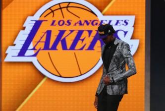 NEW YORK, NY - JUNE 23:  Brandon Ingram walks off stage after being drafted second overall by the Los Angeles Lakers in the first round of the 2016 NBA Draft at the Barclays Center on June 23, 2016 in the Brooklyn borough of New York City. NOTE TO USER: User expressly acknowledges and agrees that, by downloading and or using this photograph, User is consenting to the terms and conditions of the Getty Images License Agreement.  (Photo by Mike Stobe/Getty Images)