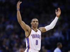 OKLAHOMA CITY, OK - FEBRUARY 8: Russell Westbrook #0 of the Oklahoma City Thunder celebrates during the game against the Los Angeles Clippers at Chesapeake Energy Arena on February 8, 2015 in Oklahoma City, Oklahoma. The Thunder defeated the Clippers 131-108. NOTE TO USER: User expressly acknowledges and agrees that, by downloading and/or using this Photograph, user is consenting to the terms and conditions of the Getty Images License Agreement. (Photo by Joe Robbins/Getty Images)
