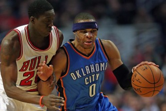 CHICAGO, IL - MARCH 05: Russell Westbrook #0 of the Oklahoma City Thunder is fouled by Tony Snell #20 of the Chicago Bulls at the United Center on March 5, 2015 in Chicago, Illinois. NOTE TO USER: User expressly acknowledges and agrees that, by downloading and or using this photograph, User is consenting to the terms and conditions of the Getty Images License Agreement. (Photo by Jonathan Daniel/Getty Images)