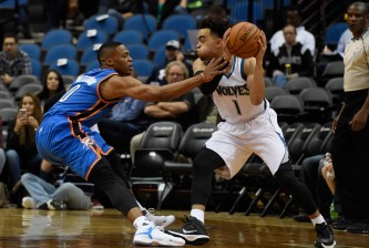 MINNEAPOLIS, MN - OCTOBER 7: Russell Westbrook #0 of the Oklahoma City Thunder reaches for the ball controlled by Tyus Jones #1 of the Minnesota Timberwolves during the first quarter of the preseason game on October 7, 2015 at Target Center in Minneapolis, Minnesota. NOTE TO USER: User expressly acknowledges and agrees that, by downloading and or using this Photograph, user is consenting to the terms and conditions of the Getty Images License Agreement. (Photo by Hannah Foslien/Getty Images)