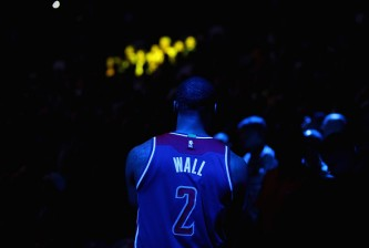 OAKLAND, CA - MARCH 29:  John Wall #2 of the Washington Wizards stands by the bench during player introductions before their game against the Golden State Warriors at ORACLE Arena on March 29, 2016 in Oakland, California. NOTE TO USER: User expressly acknowledges and agrees that, by downloading and or using this photograph, User is consenting to the terms and conditions of the Getty Images License Agreement.  (Photo by Ezra Shaw/Getty Images)