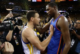 OAKLAND, CA - MAY 30:  Stephen Curry #30 of the Golden State Warriors speaks with Kevin Durant #35 of the Oklahoma City Thunder after their 96-88 win in Game Seven of the Western Conference Finals during the 2016 NBA Playoffs at ORACLE Arena on May 30, 2016 in Oakland, California. NOTE TO USER: User expressly acknowledges and agrees that, by downloading and or using this photograph, User is consenting to the terms and conditions of the Getty Images License Agreement.  (Photo by Ezra Shaw/Getty Images)