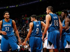 ATLANTA, GA - NOVEMBER 09:  Karl-Anthony Towns #32 and Andrew Wiggins #22 of the Minnesota Timberwolves react after Ricky Rubio #9 draws a charge from Kent Bazemore #24 of the Atlanta Hawks at Philips Arena on November 9, 2015 in Atlanta, Georgia.  NOTE TO USER User expressly acknowledges and agrees that, by downloading and or using this photograph, user is consenting to the terms and conditions of the Getty Images License Agreement.  (Photo by Kevin C. Cox/Getty Images)