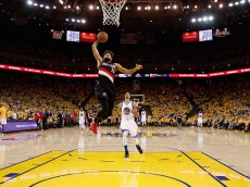 OAKLAND, CA - MAY 03:  Allen Crabbe #23 of the Portland Trail Blazers goes up for a dunk on Shaun Livingston #34 of the Golden State Warriors during Game Two of the Western Conference Semifinals during the 2016 NBA Playoffs on May 3, 2016 at Oracle Arena in Oakland, California.  NOTE TO USER: User expressly acknowledges and agrees that, by downloading and or using this photograph, User is consenting to the terms and conditions of the Getty Images License Agreement.  (Photo by Ezra Shaw/Getty Images)