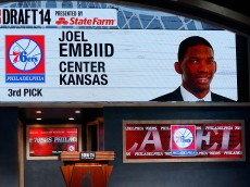 NEW YORK, NY - JUNE 26:  A video screen shows the selection of Joel Embiid of Kansas as the #3 overall pick in the first round by the Philadelphia 76ers during the 2014 NBA Draft at Barclays Center on June 26, 2014 in the Brooklyn borough of New York City. NOTE TO USER: User expressly acknowledges and agrees that, by downloading and/or using this Photograph, user is consenting to the terms and conditions of the Getty Images License Agreement.  (Photo by Mike Stobe/Getty Images)