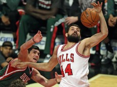 CHICAGO, IL - FEBRUARY 23: Nikola Mirotic #44 of the Chicago Bulls rebounds over Ersan Ilyasova #7 of the Milwaukee Bucks at the United Center on February 23, 2015 in Chicago, Illinois. NOTE TO USER: User expressly acknowledges and agrees that, by downloading and or using this photograph, User is consenting to the terms and conditions of the Getty Images License Agreement. (Photo by Jonathan Daniel/Getty Images)