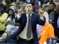 MEMPHIS, TN - APRIL 24:  Dave Joerger the head coach of the Memphis Grizzlies gives instructions to his team against the Oklahoma City Thunder during  Game 3 of the Western Conference Quarterfinals during the 2014 NBA Playoffs at FedExForum on April 24, 2014 in Memphis, Tennessee. NOTE TO USER: User expressly acknowledges and agrees that, by downloading and or using this photograph, User is consenting to the terms and conditions of the Getty Images License Agreement.  (Photo by Andy Lyons/Getty Images)