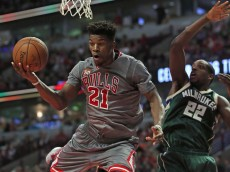 CHICAGO, IL - JANUARY 05: Jimmy Butler #21 of the Chicago Bulls falls to the floor after being fouled by Khris Middleton #22 of the Milwaukee Bucks at the United Center on January 5, 2016 in Chicago, Illinois. The Bulls defeated the Bucks 117-106. NOTE TO USER: User expressly acknowledges and agrees that, by downloading and or using the photograph, User is consenting to the terms and conditions of the Getty Images License Agreement. (Photo by Jonathan Daniel/Getty Images)