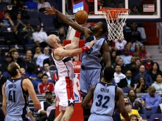 WASHINGTON, DC - MARCH 12: Marcin Gortat #4 of the Washington Wizards puts up a shot past JaMychal Green #0 of the Memphis Grizzlies in the first half at Verizon Center on March 12, 2015 in Washington, DC. NOTE TO USER: User expressly acknowledges and agrees that, by downloading and or using this photograph, User is consenting to the terms and conditions of the Getty Images License Agreement. (Photo by Patrick Smith/Getty Images)