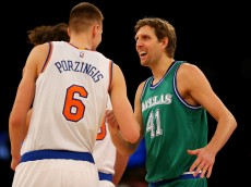 NEW YORK, NY - DECEMBER 07:  Kristaps Porzingis #6 of the New York Knicks and Dirk Nowitzki #41 of the Dallas Mavericks greet each other before the opening tipoff at Madison Square Garden on December 7, 2015 in New York City. NOTE TO USER: User expressly acknowledges and agrees that, by downloading and/or using this Photograph, user is consenting to the terms and conditions of the Getty Images License Agreement.  (Photo by Elsa/Getty Images)