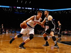 NEW YORK, NY - JANUARY 13:  Kristaps Porzingis #6 of the New York Knicks in action against Andrea Bargnani #9 of the Brooklyn Nets during their game at the Barclays Center on January 13, 2016 in New York City.  NOTE TO USER: User expressly acknowledges and agrees that, by downloading and/or using this Photograph, user is consenting to the terms and conditions of the Getty Images License Agreement.  (Photo by Al Bello/Getty Images)