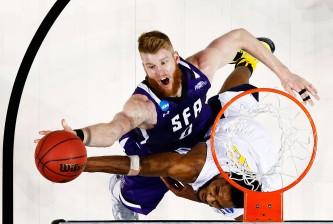 NEW YORK, NY - MARCH 18:  Thomas Walkup #0 of the Stephen F. Austin Lumberjacks shoots against Elijah Macon #45 of the West Virginia Mountaineers in the second half during the first round of the 2016 NCAA Men's Basketball Tournament at Barclays Center on March 18, 2016 in the Brooklyn borough of New York City.  (Photo by Al Bello/Getty Images)