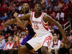 HOUSTON, TEXAS - APRIL 10: Clint Capela #15 of the Houston Rockets blocks out Kobe Bryant #24 of the Los Angeles Lakers duiring a free throw attempt at Toyota Center on April 10, 2016 in Houston, Texas. (Photo by Bob Levey/Getty Images)