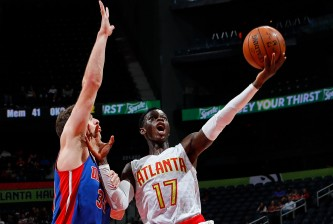 ATLANTA, GA - OCTOBER 13:  Dennis Schroder #17 of the Atlanta Hawks drives against Jon Leuer #30 of the Detroit Pistons at Philips Arena on October 13, 2016 in Atlanta, Georgia.  NOTE TO USER User expressly acknowledges and agrees that, by downloading and or using this photograph, user is consenting to the terms and conditions of the Getty Images License Agreement.  (Photo by Kevin C. Cox/Getty Images)