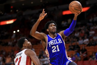 MIAMI, FL - OCTOBER 21:  Joel Embiid #21 of the Philadelphia 76ers drives on Hassan Whiteside #21 of the Miami Heat during a preseason game  at American Airlines Arena on October 21, 2016 in Miami, Florida.  (Photo by Mike Ehrmann/Getty Images)